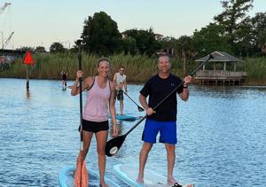 Lauren and Matt Merritt paddle boarding